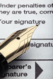 Pen and tax form Royalty Free Stock Photos