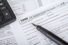 Pen with tax form and calculator Royalty Free Stock Photo