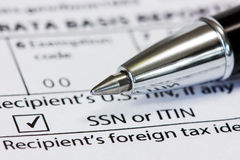 Pen and  tax form. Close-up pen on the US tax form Royalty Free Stock Images
