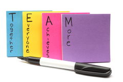 Pen with Team together everyone achieves more. A black felt marker pen with Team together everyone achieves more royalty free stock photo