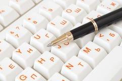 Pen on thekeyboard Royalty Free Stock Photo