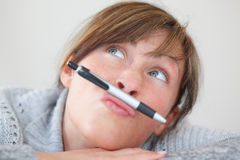 Pen thinking woman Stock Images