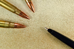 Pen and three bullets Stock Image