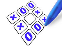 Pen&tic-tac-toe. A pen with tic-tac-toe, white background Stock Photos