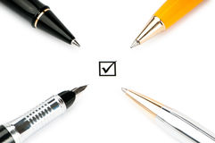 Pen and tick boxes Stock Images