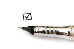 Pen and ticked tick box Stock Photography