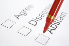 Pen on top 'Abstain' checkbox Stock Image