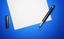 Pen on top of blank sheet of paper Stock Image