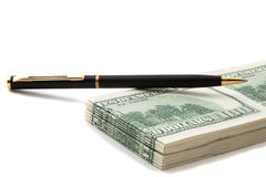 Pen on top of a stack of cash Royalty Free Stock Photo