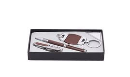 Pen and trinket in a box. Royalty Free Stock Photos