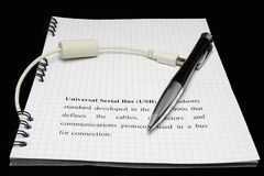 Pen and usb cable Stock Images