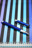 Pen a striped notebook Royalty Free Stock Images