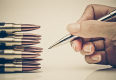 Pen vs. Bullet. / Freedom of the press is at risk concept / World press freedom day concept Stock Photos