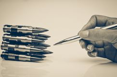 Pen vs. Bullet. / Freedom of the press is at risk concept / World press freedom day concept Stock Image