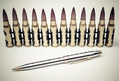 Pen vs. Bullet. / Freedom of the press is at risk concept / World press freedom day concept Royalty Free Stock Image