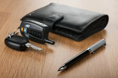 Pen wallet and car keys lay on parquet Royalty Free Stock Images