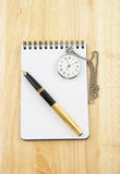 Pen, watch and blank note pad Stock Images