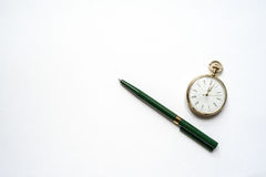 Pen and watch. Always do all the time Royalty Free Stock Image