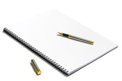 Pen on white notebook Stock Images