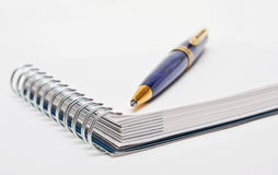 Pen on a white page of notebook Royalty Free Stock Photos