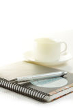 Pen on a white paper with cup. Of coffee Royalty Free Stock Image