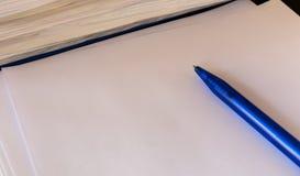 Pen on a white sheet Royalty Free Stock Photos