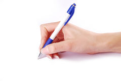 Pen in woman hand Stock Photos