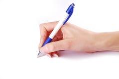 Pen in woman hand stock photos
