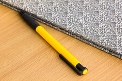 Pen on the wooden desk Royalty Free Stock Image