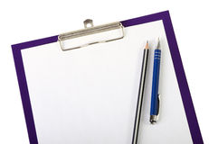 Pen and wooden pencil on clipboard closeup Royalty Free Stock Photo