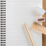 Pen, wooden ruler, pencil sharpener and white eraser set on diar Royalty Free Stock Photos