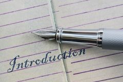 Pen and word Introduction. Closeup of a fountain pen and word Introduction written in script letters stock image