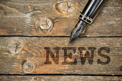 Pen and word News Stock Photo