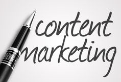 Pen writes content  marketing on paper Royalty Free Stock Images