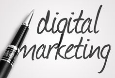 Pen writes digital  marketing on paper Royalty Free Stock Photo