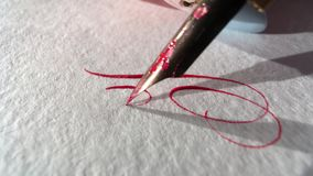 Pen writes on paper. Very close-up stock video