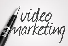 Pen writes video marketing on paper Royalty Free Stock Photography