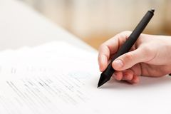 Pen writing business document Stock Image