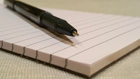 Pen and writing pad Stock Photo