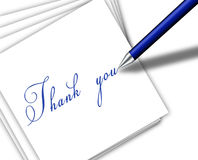 Pen writing thank you on the paper Royalty Free Stock Image
