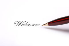 Pen writing welcome text Stock Photography