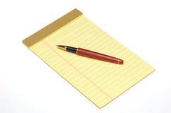 Pen on Yellow Pad Stock Photo