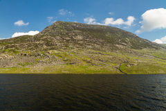 Pen yr Ole Wen mountain with Lake Llyn Ogwen in the foreground. Royalty Free Stock Images
