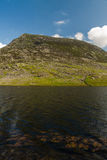 Pen yr Ole Wen mountain with Lake Llyn Ogwen in the foreground. Stock Photo