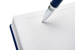 Pena acima de um caderno Imagens de Stock
