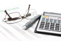 Pena, calculadora e vidros Imagens de Stock