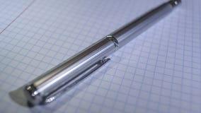 Pena cara do metal em um caderno na caixa Imagem de Stock Royalty Free