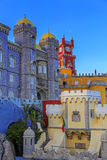 Pena castle red clock tower and blue mosaic towers in Sintra Stock Photo