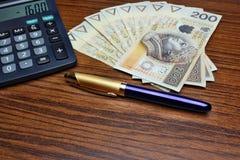 Pena da calculadora do dinheiro Fotos de Stock