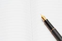 Pena da tinta com bloco de notas Imagem de Stock